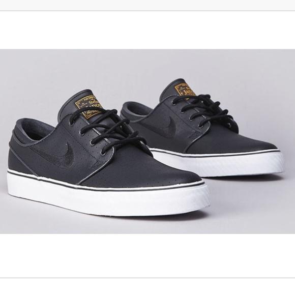 Nike SB Zoom Stefan Janoski black leather sneakers.  M 5b755c020945e04f4cf544b3 b3c629a129